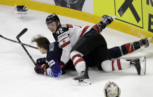 Canada's Anthony Beauvillier, above, and Connor Murphy of the United States fall a tackle during the Ice Hockey World Championships bronze medal match between Canada and the United States at the Royal arena in Copenhagen, Denmark, Sunday, May 20, 2018. (AP Photo/Petr David Josek)