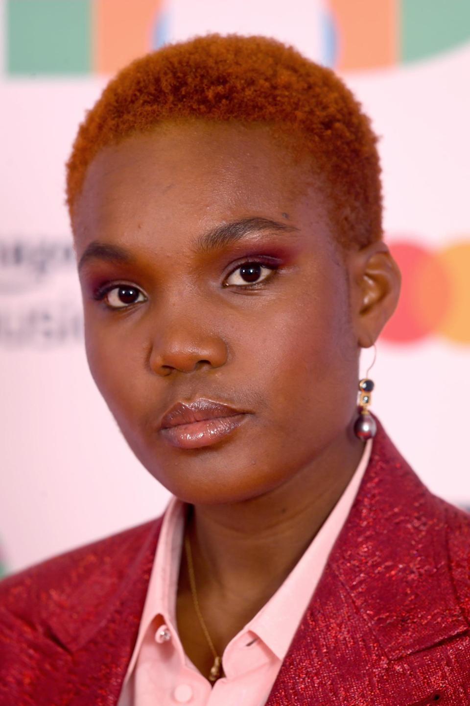 <p>Parks paired her signature short crop with a gorgeous reddish-purple eyeshadow and beautiful glowing skin.</p>