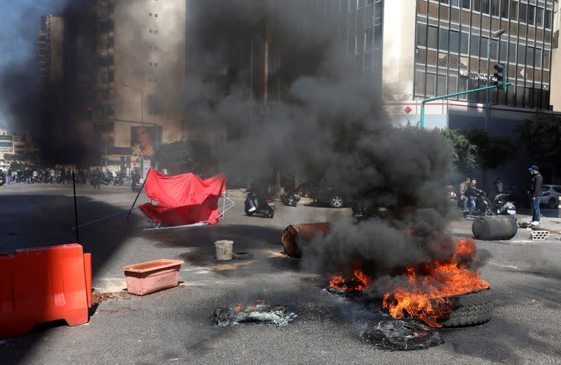 Demonstrators block a road during a protest in Beirut