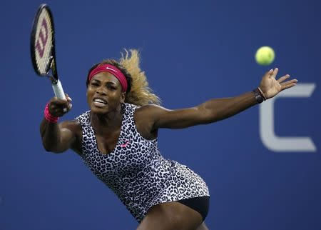 Serena Williams of the U.S. returns a shot to compatriot Taylor Townsend during their women's singles match at the U.S. Open tennis tournament in New York, August 26, 2014. REUTERS/Shannon Stapleton
