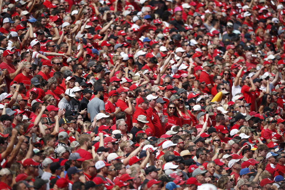 FILE - In this Sept. 7, 2019, file photo, Nebraska fans are shown in the first half of an NCAA college football game in Boulder, Colo. With each passing day it is becoming apparent the COVID-19 pandemic is going to make the goal to have all 130 major college football teams, spread across 41 states, start the upcoming season at the same time, and play the same number of games, difficult to achieve. (AP Photo/David Zalubowski, File)
