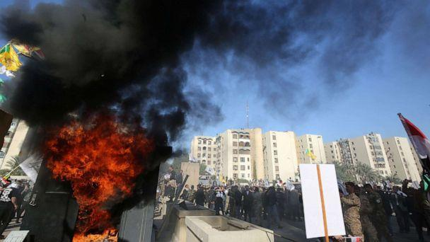PHOTO: Iraqi protesters set fire to a guard outside the U.S. embassy building in the capital, Baghdad, to protest airstrikes by U.S. aircraft on December 31, 2019 at multiple bases. (Ahmad Al-rubaye / AFP via Getty Images)
