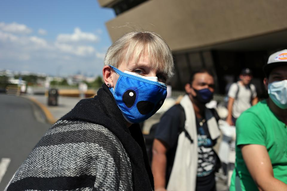 20 March 2020, Philippines, Manila: A woman with a mask is walking to the airport building. More than 300 Germans are waiting at Ninoy Aquino International Airport for a Lufthansa flight chartered by the German Embassy in the Philippines because of the Covid 19 pandemic. Photo: Alejandro Ernesto//Alejandro Ernesto/DPA (Photo by Alejandro Ernesto/picture alliance via Getty Images)