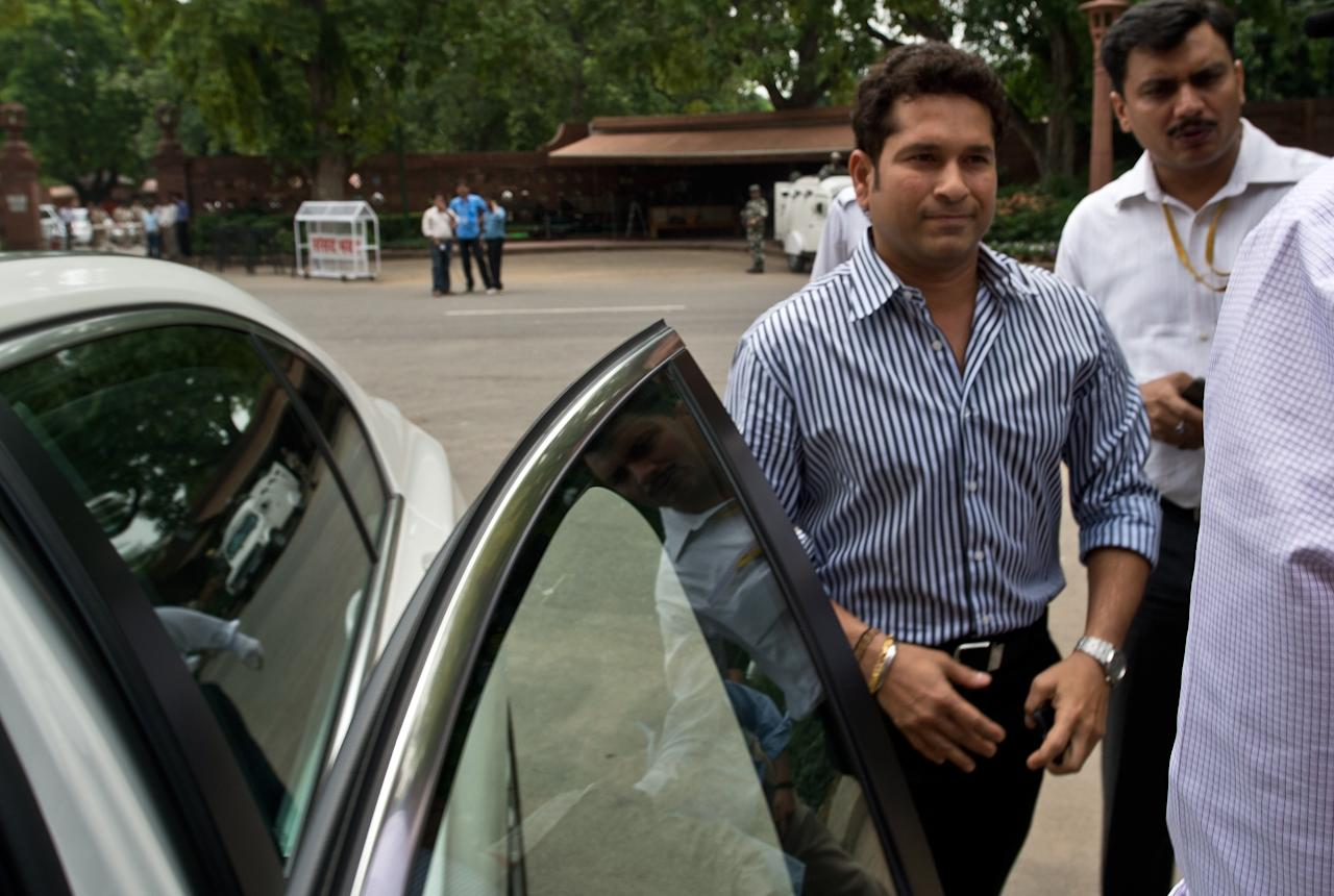 Indian cricketer and Member of Parliament, Rajya Sabha (Upper House) Sachin Tendulkar arrives at Parliament in New Delhi on August 5, 2013. India's parliament is due to start the monsoon session with the government under intense pressure to pass key bills ahead of upcoming elections due by next year.  AFP PHOTO/ Prakash SINGH        (Photo credit should read PRAKASH SINGH/AFP/Getty Images)
