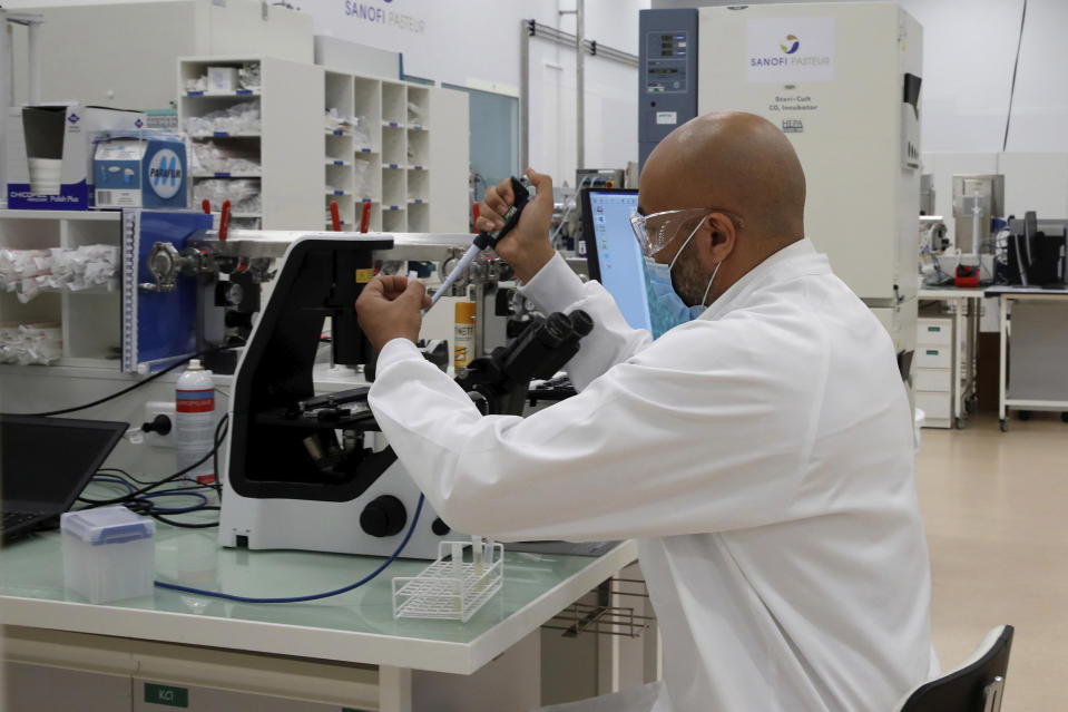 A researcher works at an industrial development laboratory at the French drugmaker's vaccine unit Sanofi Pasteur plant in Marcy-l'Etoile, near Lyon, central France, Tuesday, June 16, 2020. The visit comes after rival pharmaceutical company AstraZeneca this weekend announced a deal to supply 400 million vaccine doses to EU countries, including France. (Gonzalo Fuentes/Pool via AP)