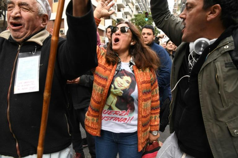Kirchner's supporters demonstrated outside her Buenos Aires home as the police search unfolded