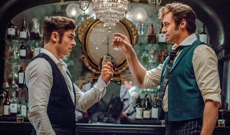 Zac Efron and Hugh Jackman in 'The Greatest Showman' (credit: 20th Century Fox)