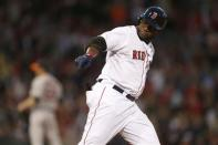 Boston Red Sox's David Ortiz points to the dugout as he rounds first base on a solo home run in the third inning of a baseball game against the Houston Astros in Boston, Thursday, April 25, 2013. (AP Photo/Michael Dwyer)
