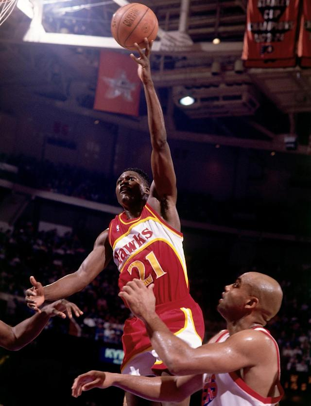 Dominique Wilkins soars over Charles Barkley and the Sixers. (Nathaniel S. Butler/NBAE via Getty Images)