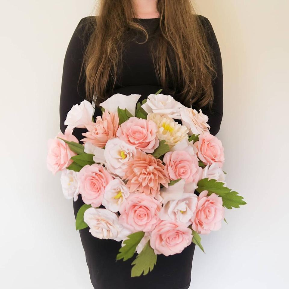 a wedding bouquet made of paper flowers with a cricut