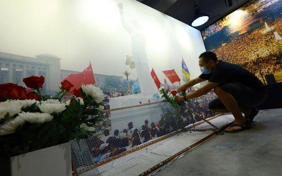 A volunteer last month prepares for the reopening of a new exhibition at the June 4 museum in Mong Kok. Photo: May Tse
