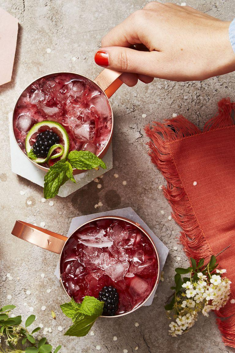 """<p>This isn't your run-of-the-mill moscow mule. Fresh blackberries give this version a gorgeous red hue that'll outshine the cute copper mugs. </p><p><em><a href=""""https://www.goodhousekeeping.com/food-recipes/a22576635/blackberry-mint-moscow-mules-recipe/"""" rel=""""nofollow noopener"""" target=""""_blank"""" data-ylk=""""slk:Get the recipe for Blackberry Mint Moscow Mule »"""" class=""""link rapid-noclick-resp"""">Get the recipe for Blackberry Mint Moscow Mule »</a></em><br></p>"""