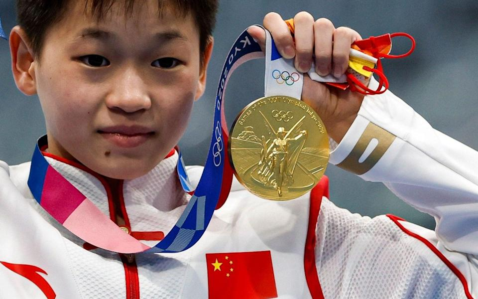 Quan Hongchan poses with her gold medal - SHUTTERSTOCK