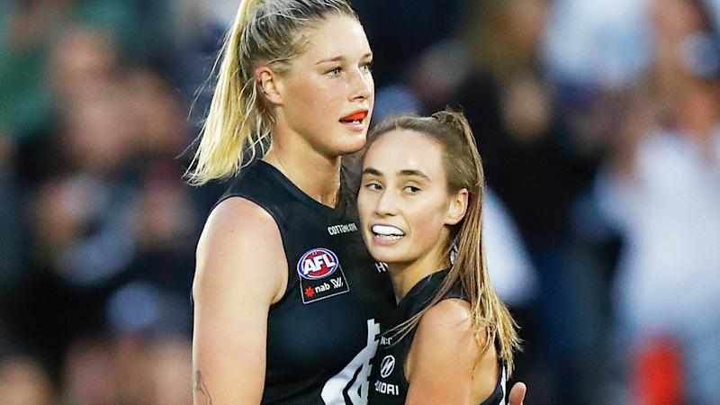 Tayla Harris and Georgia Gee of the Blues celebrate during a match against St Kilda.