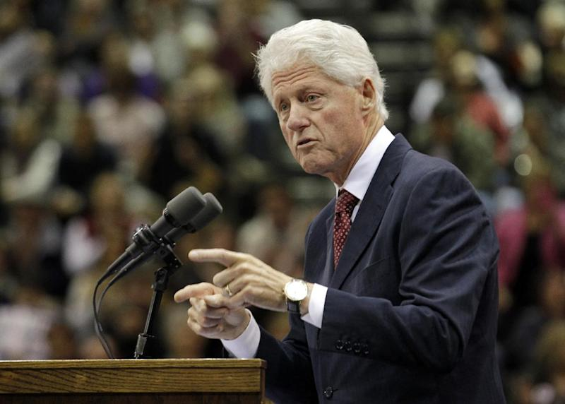 "Former President Bill Clinton speaks at a ""Hoosier Common Sense"" rally for Indiana Democratic Senate candidate Joe Donnelly and Indiana Democratic gubernatorial candidate John Gregg in Indianapolis, Friday, Oct. 12, 2012. (AP Photo/Michael Conroy)"