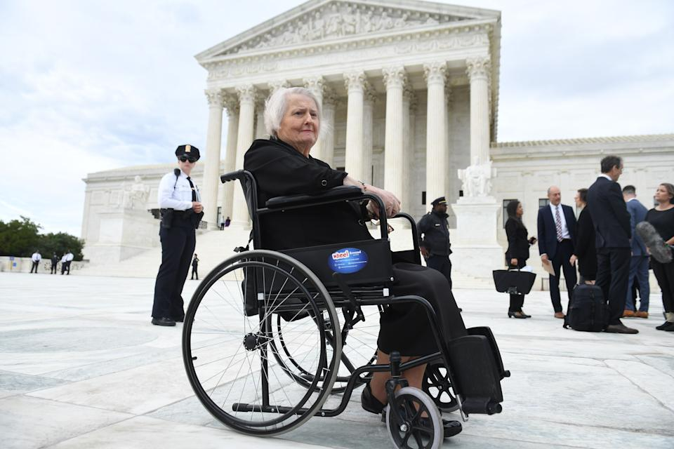 Transgender activist Aimee Stephens outside the US Supreme Court in Oct., 2019, as the Court held oral arguments in three cases dealing with workplace discrimination, including her firing by a Detroit funeral home. She died in May, before being able to see her SCOTUS victory, along with that of Donald Zarda who died in 2014) and Gerald Bostock. (Photo: SAUL LOEB/AFP via Getty Images)