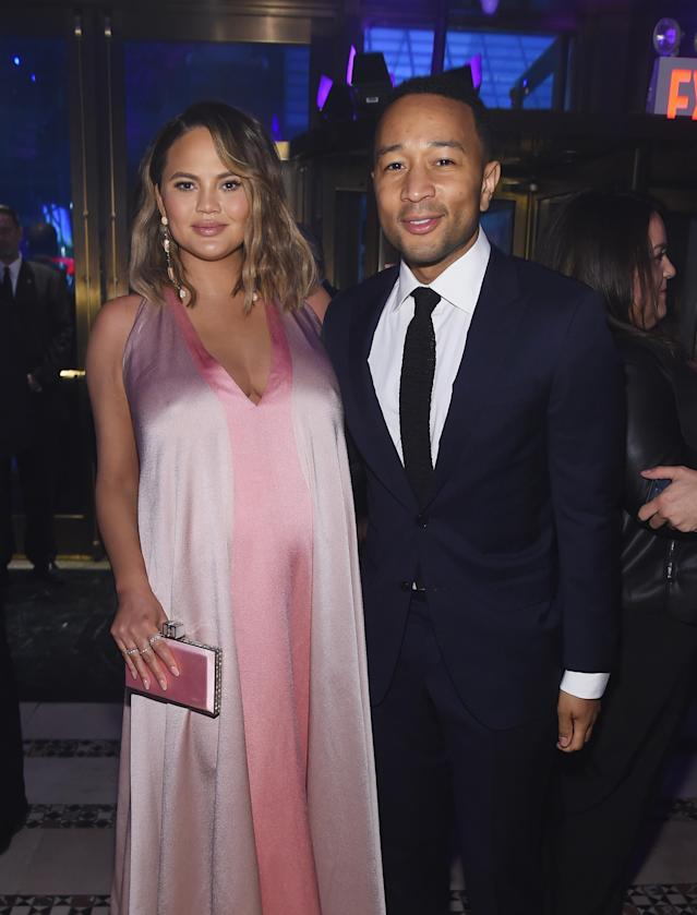 Proud parents Chrissy Teigen and John Legend, photographed weeks before Miles's birth. (Photo: Jamie McCarthy/Getty Images for City Harvest)