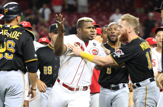 Yasiel Puig's last act as a member of the Reds involved jumping into a brawl against the Pirates after he had been traded. (Getty)