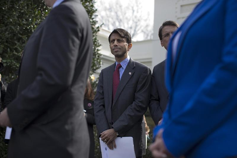 Louisiana Gov. Bobby Jindal listens as National Governors Association Chairman, Delaware Gov. Jack Markell, speaks with reporters outside the White House in Washington, Monday, Feb. 25, 2013, following their meeting with President Barack Obama. (AP Photo/Evan Vucci)