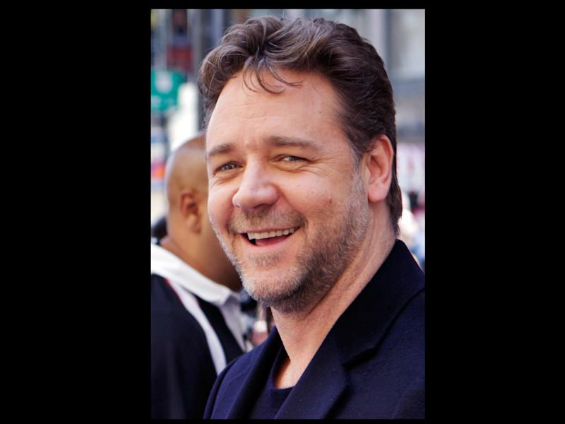 FILE -In an April 12. 2010 file photo actor Russell Crowe smiles as he is interviewed, after being honored with a star on the Hollywood Walk of Fame in Los Angeles. Crowe lost his way kayaking in the waters off New York's Long Island and was picked up by a U.S. Coast Guard boat and ferried to a harbor, officials said Sunday Sept. 2, 2012. (AP Photo/Damian Dovarganes/file)