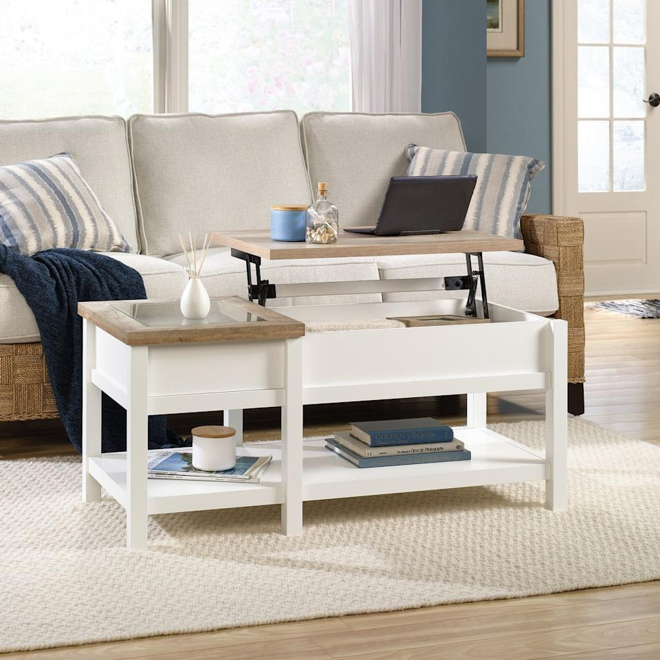 """<p>How smart is this <a href=""""https://www.popsugar.com/buy/Sauder-Cottage-Road-Lift-Top-Coffee-Table-494369?p_name=Sauder%20Cottage%20Road%20Lift%20Top%20Coffee%20Table&retailer=walmart.com&pid=494369&price=157&evar1=casa%3Aus&evar9=46006662&evar98=https%3A%2F%2Fwww.popsugar.com%2Fphoto-gallery%2F46006662%2Fimage%2F46679513%2FSauder-Cottage-Road-Lift-Top-Coffee-Table&list1=shopping%2Chome%20decor%2Cfurniture%2Cliving%20rooms%2Chome%20shopping&prop13=api&pdata=1"""" rel=""""nofollow"""" data-shoppable-link=""""1"""" target=""""_blank"""" class=""""ga-track"""" data-ga-category=""""Related"""" data-ga-label=""""https://www.walmart.com/ip/Sauder-Cottage-Road-Lift-Top-Coffee-Table-Soft-White-Finish/616404951"""" data-ga-action=""""In-Line Links"""">Sauder Cottage Road Lift Top Coffee Table</a> ($157)?</p>"""