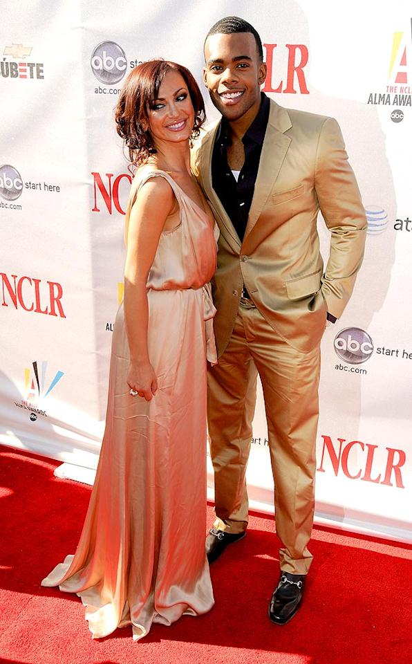 """Dancing With the Stars"" partners Karina Smirnoff and Mario may have been golden on the dance floor, but they won't be receiving high marks for Mario's wrinkled pants or wife beater tank top. Gregg DeGuire/<a href=""http://www.wireimage.com"" target=""new"">WireImage.com</a> - August 17, 2008"