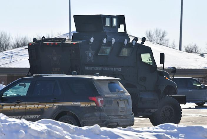 A Wright County Sheriff's Department armored vehicle is stationed near the Super 8 Motel Tuesday, Feb. 9, 2021, in Buffalo.
