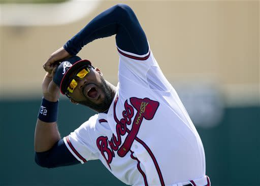 Atlanta Braves outfielder Jason Heyward stretches before an exhibition spring training baseball game against the Houston Astros, Thursday, March 28, 2013, in Kissimmee, Fla. (AP Photo/Evan Vucci)
