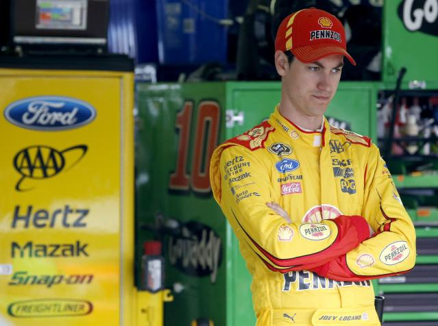 Joey Logano stands by himself in the garage during NASCAR Sprint Cup auto racing practice Saturday, March 1, 2014, in Avondale, Ariz. (AP Photo/Ross D. Franklin)