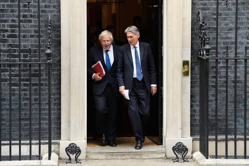 Britain's Foreign Secretary Boris Johnson (L) and Chancellor Philip Hammond leave number 10, Downing Street. Photo by Leon Neal/Getty Images