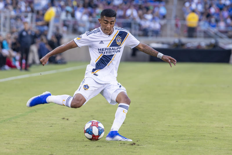 PALO ALTO, CA - JUNE 29: Los Angeles Galaxy defender Julian Araujo (22) crosses the ball into the box during the MLS game between the Los Angeles Galaxy and San Jose Earthquakes on June 29, 2019 at Stanford Stadium in Palo Alto, CA (Photo by Bob Kupbens/Icon Sportswire via Getty Images)