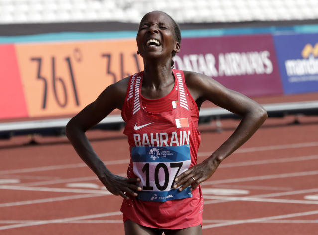 Bahrain's Rose Chelimo reacts after winning the women's marathon during the athletics competition at the 18th Asian Games in Jakarta, Indonesia, Sunday, Aug. 26, 2018. (AP Photo/Lee Jin-man)