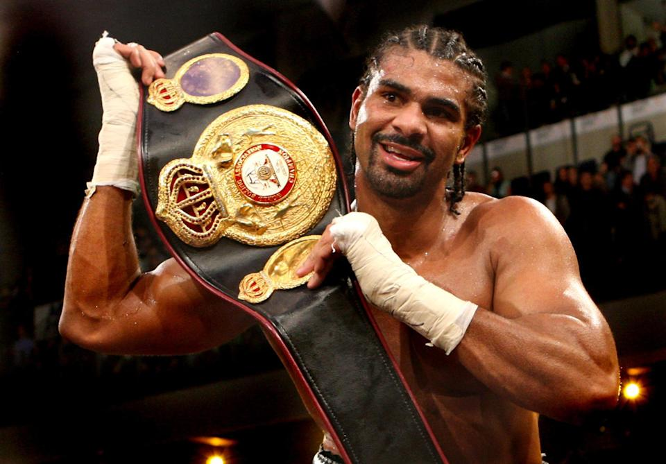 England's David Haye celebrates becoming the new WBA World Heavyweight Champion by lifting up the belt after his points win against Nikolai Valuev in the WBA World Heavyweight Title bout at the Nuremberg Arena, Germany.