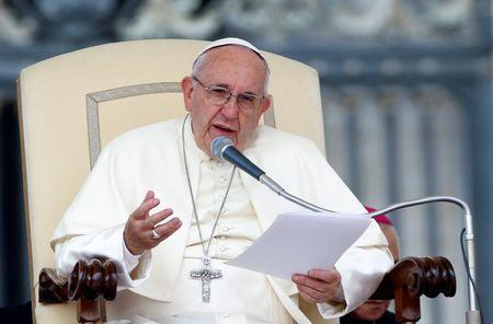 Pope Francis speaks as he leads the weekly audience in Saint Peter's Square at the Vatican