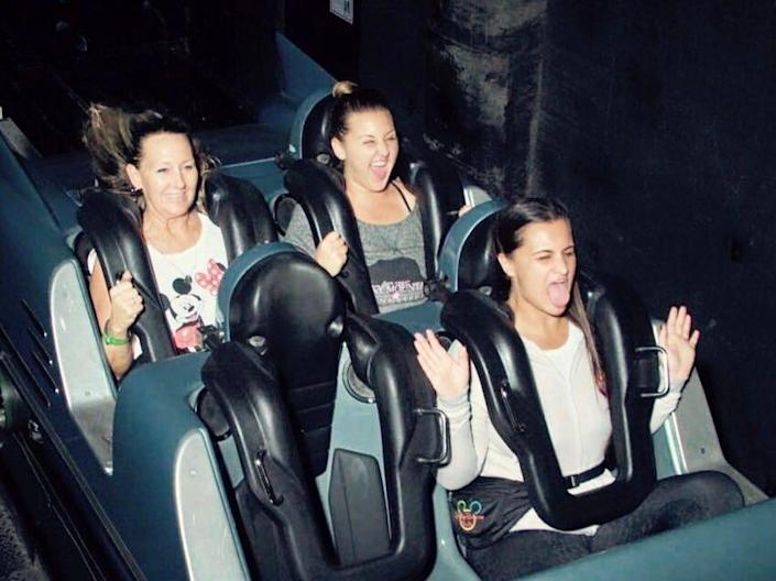 carly and two other people at the photo spot on rockn roller coaster at hollywood studios