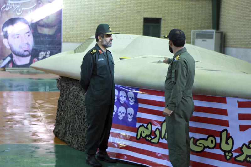 A photo released by Iran in 2011 purports to show Gen. Amir Ali Hajizadeh, left, the chief of the aerospace division of the Iran Revolutionary Guard Corps, listening to an unidentified colonel as he points to a downed U.S. RQ-170 Sentinel drone