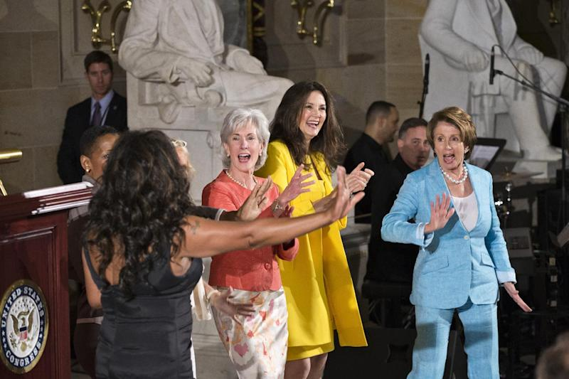 """From right, House Minority Leader Nancy Pelosi, D-Calif., actor and political activist Lynda Carter, and Health and Human Services Secretary Kathleen Sebelius, join singer Mary Wilson, far left, and dance to The Supremes song """"Stop in the Name of Love,"""" during a celebration of the career of veteran congressman John Dingell, in Washington, Thursday, June 13, 2013. (AP Photo/J. Scott Applewhite)"""