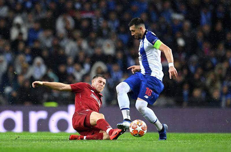 James Milner of Liverpool battles for possession with Hector Herrera during the UEFA Champions League Quarter Final second leg match between Porto and Liverpool.