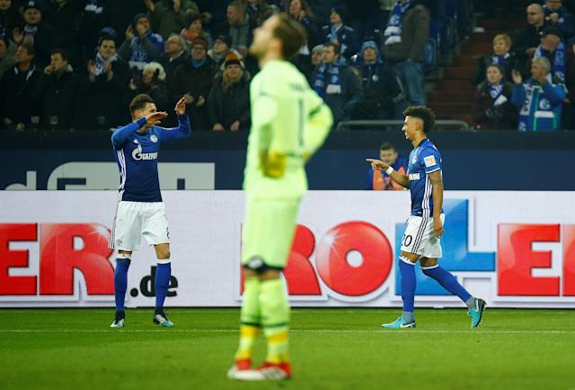 Soccer Football - Bundesliga - Schalke 04 vs TSG 1899 Hoffenheim - Veltins-Arena, Gelsenkirchen, Germany - February 17, 2018 Schalke's Thilo Kehrer celebrates with Leon Goretzka after scoring their first goal REUTERS/Leon Kuegeler DFL RULES TO LIMIT THE ONLINE USAGE DURING MATCH TIME TO 15 PICTURES PER GAME. IMAGE SEQUENCES TO SIMULATE VIDEO IS NOT ALLOWED AT ANY TIME. FOR FURTHER QUERIES PLEASE CONTACT DFL DIRECTLY AT + 49 69 650050