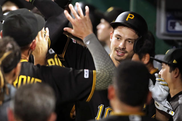 Pittsburgh Pirates' Bryan Reynolds, right, celebrates in the dugout after hitting a three-run home run off Detroit Tigers relief pitcher Nick Ramirez during the sixth inning of a baseball game in Pittsburgh, Wednesday, June 19, 2019. (AP Photo/Gene J. Puskar)