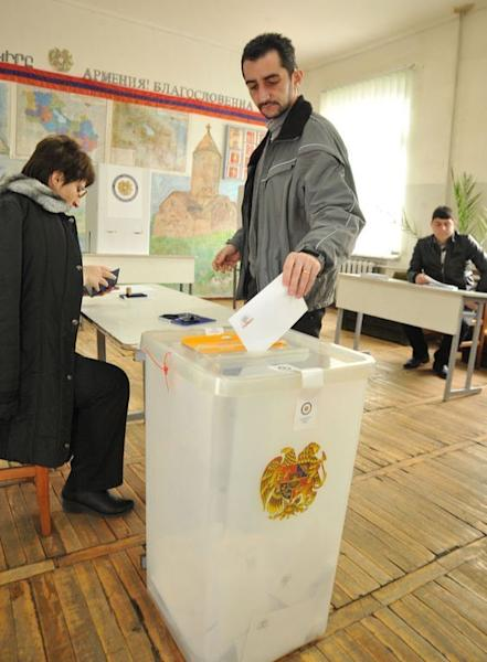 An Armenian casts his ballot at a poling station in Yerevan on February 18, 2013. Voter turnout was 60 percent in the polls seen as a crucial democratic test for the former Soviet state