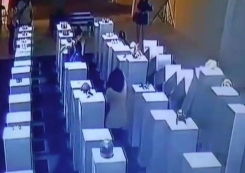 An LA gallery has denied a costly viral mishap was a publicity stunt, where CCTV shows a woman creating a domino effect of expensive artwork. Picture: YouTube