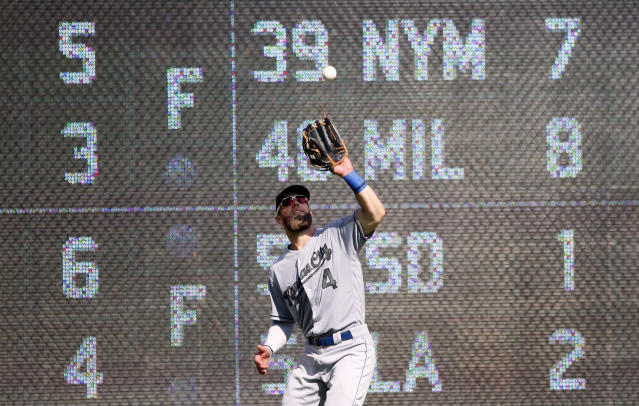 Kansas City Royals left fielder Alex Gordon (4) makes a catch on a fly ball by Texas Rangers Ronald Guzman during the ninth inning of a baseball game Sunday, May 27, 2018, in Arlington, Texas. (AP Photo/Michael Ainsworth)