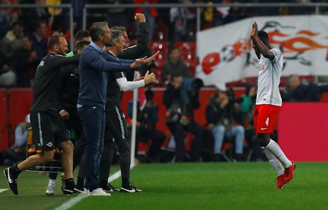 Soccer Football - Europa League Semi Final Second Leg - RB Salzburg v Olympique de Marseille - Red Bull Arena, Salzburg, Austria - May 3, 2018 RB Salzburg's Amadou Haidara celebrates with coaching staff REUTERS/Leonhard Foeger