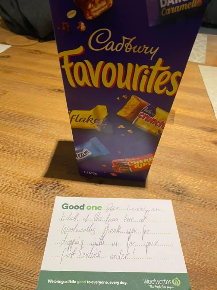 Pictured is a note from Woolworths supermarket alongside a box of Cadbury Favourites.