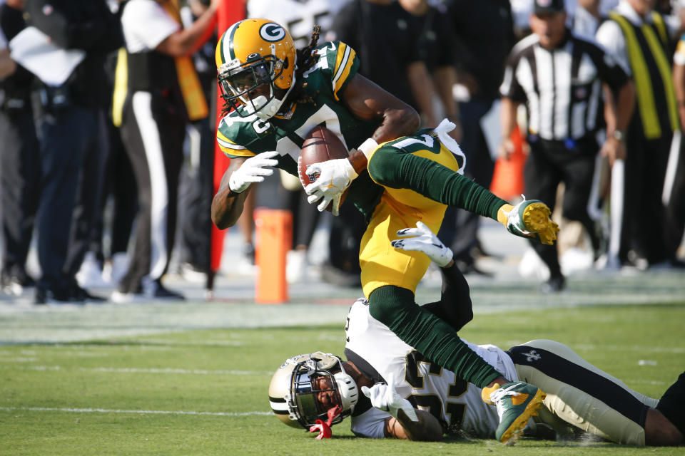 Green Bay Packers wide receiver Davante Adams (17) catches a pass as New Orleans Saints cornerback Marshon Lattimore, lower left, tries to stop him during the first half of an NFL football game, Sunday, Sept. 12, 2021, in Jacksonville, Fla. (AP Photo/Stephen B. Morton)