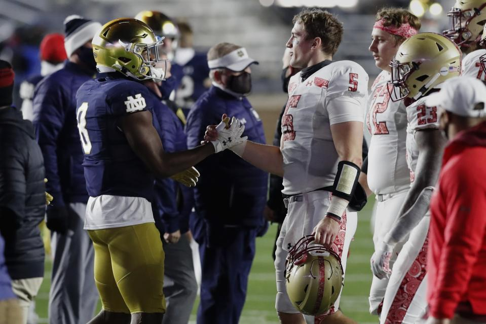 Boston College quarterback Phil Jurkovec (5) greets Notre Dame running back Jafar Armstrong (8) following an NCAA college football game Saturday, Nov. 14, 2020, in Boston. (AP Photo/Michael Dwyer)