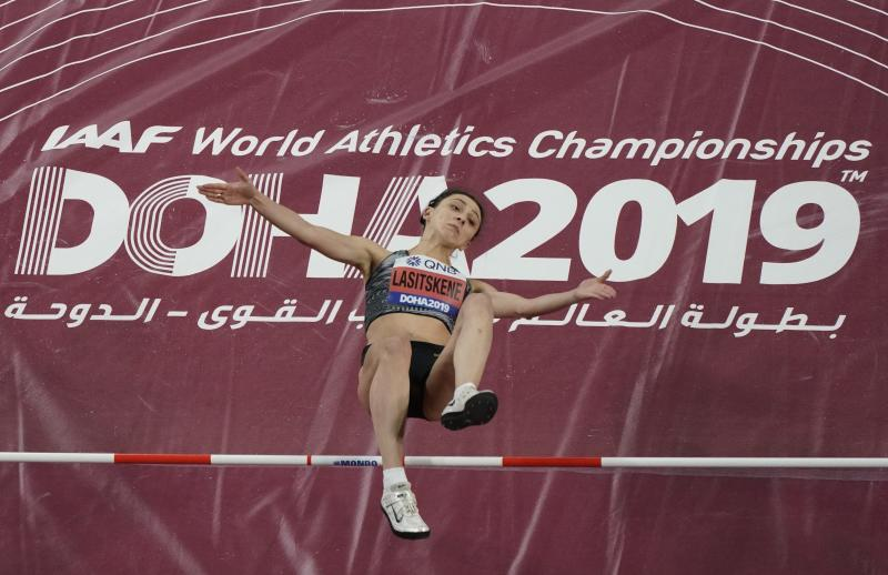 Mariya Lasitskene, of participates as a neutral athlete, clears the bar during the women's high jump finals at the World Athletics Championships in Doha, Qatar, Monday, Sept. 30, 2019. (AP Photo/Morry Gash)