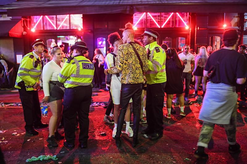 LONDON, ENGLAND - JULY 04: Police officers are seen breaking up a fight outside a pub in Soho on July 4, 2020 in London, United Kingdom. The UK Government announced that Pubs, Hotels and Restaurants can open from Saturday, July 4th providing they follow guidelines on social distancing and sanitising. (Photo by Peter Summers/Getty Images)