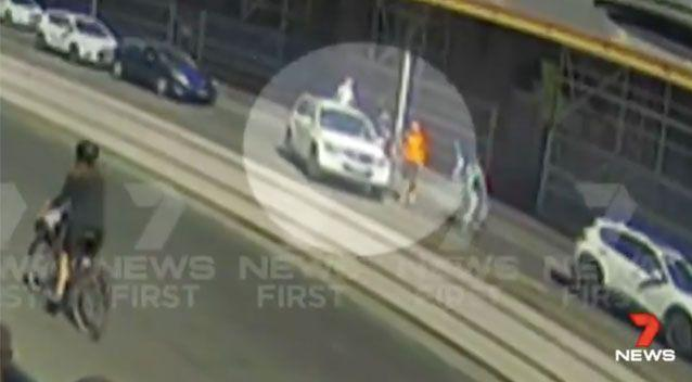The 4WD had paused for around seven seconds before narrowly missing this man in orange. Source: 7 News